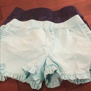 2 pairs of Carters size 5 ruffle shorts